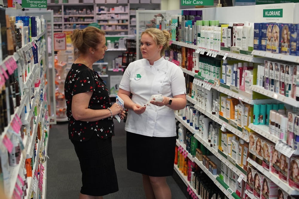Pharmacist with customer 2